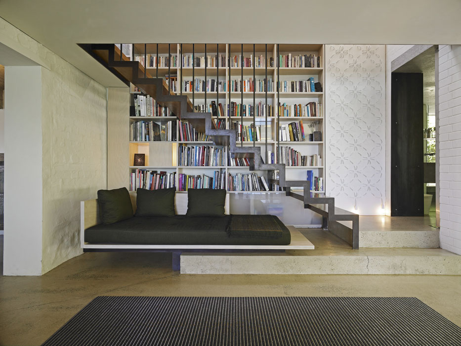 Modern-Home-Library-Behind-the-Stairs-Design